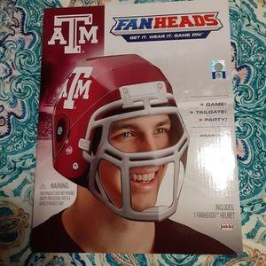 Texas A&M fan heads helmet